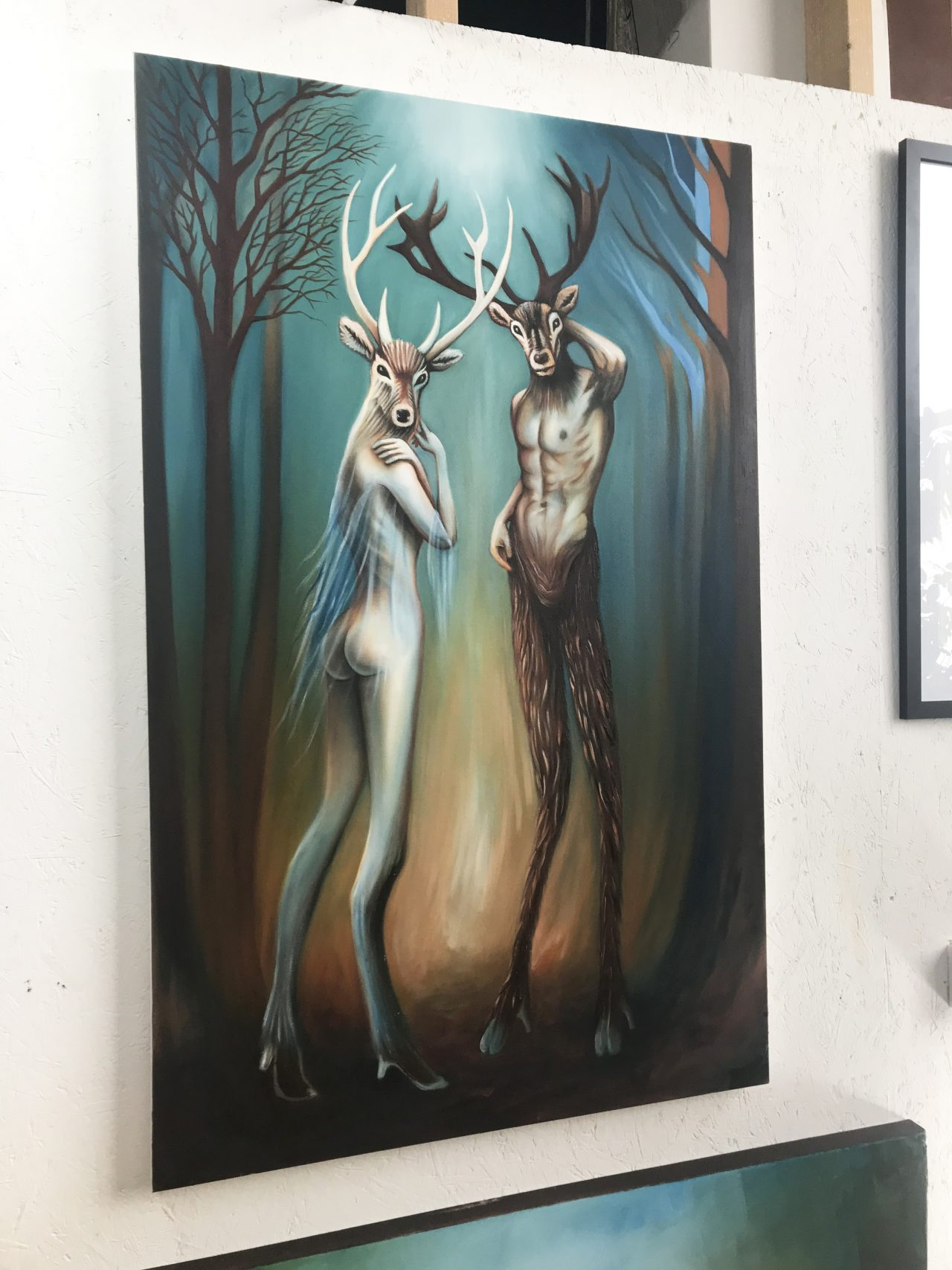 Exiles in Eden - contemporary oil painting of anthropomorphic human hybrid deer and stag in an enchanted forest