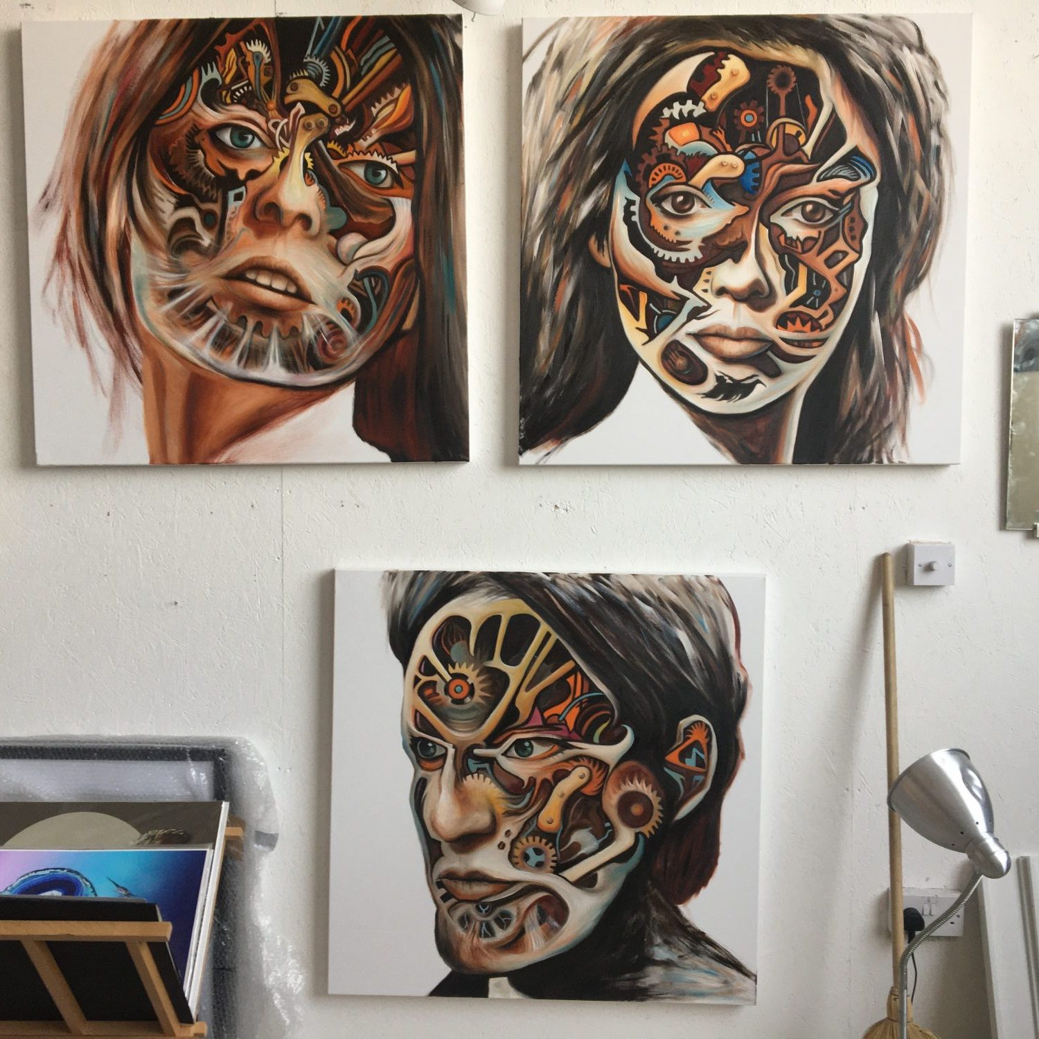 The Mechanical Paradise paintings on the studio wall