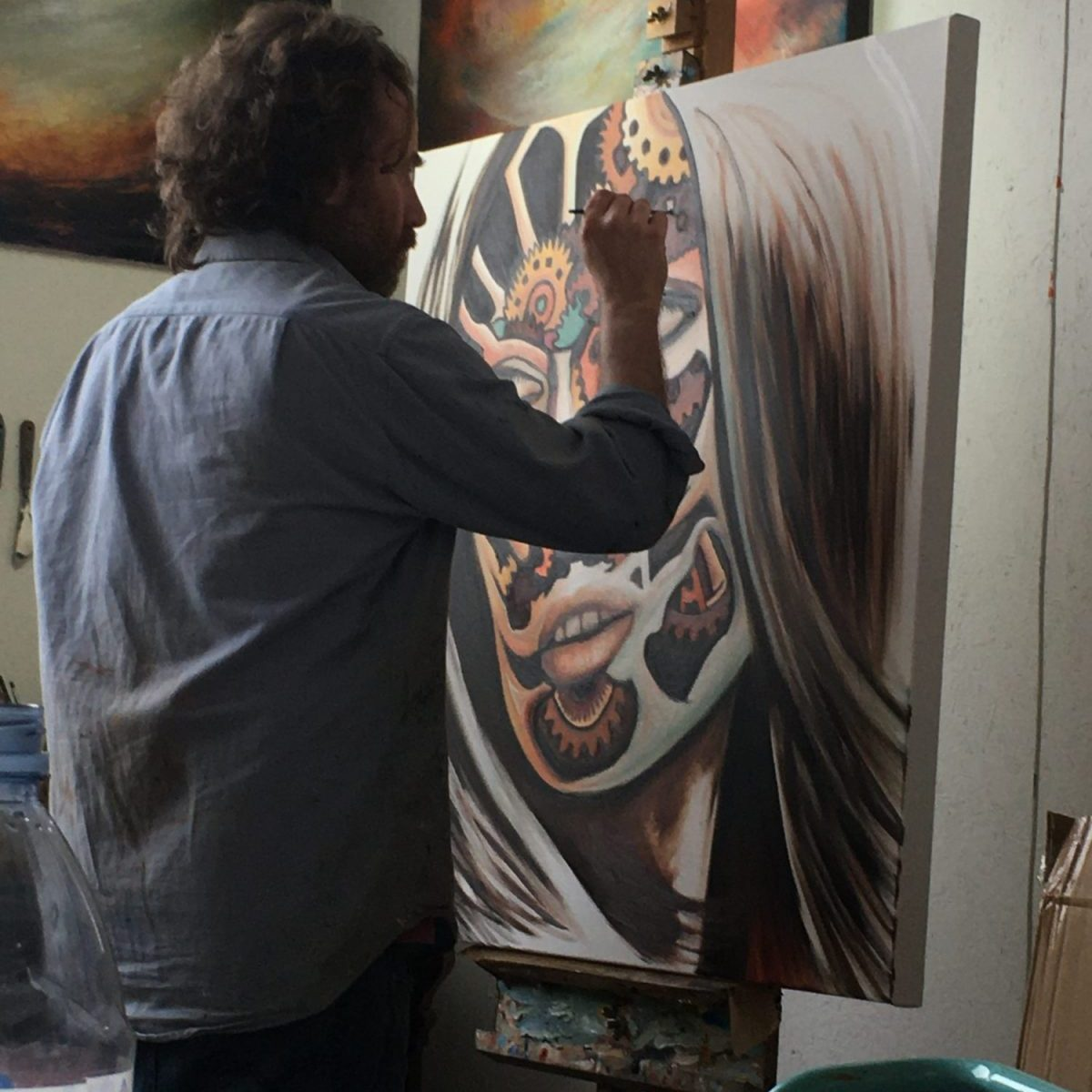 "Paul kingsley Squire in his North London studio working on ""Medea"" from the Mechanical Paradise series of oil paintings"